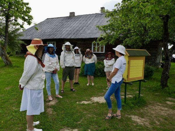 Local guide sharing stories about beekeeping traditions in Lithuania