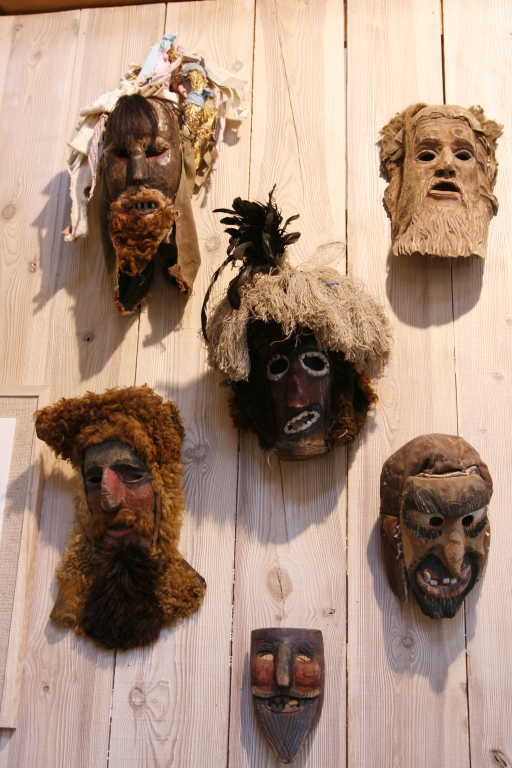 Wooden Mardi Gras mask depicting devils and witches