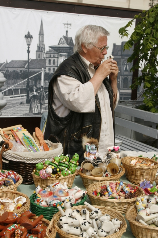 Craftsman demonstrating his art at the market in the Old town of Klaipeda